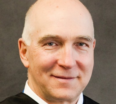 Judge in Colorado shooting must decide fair trial versus transparency