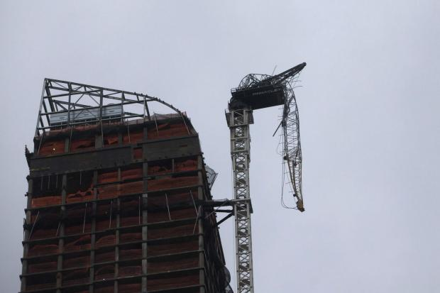 Hurricane Hits: Crane dangles from NYC high-rise, clearing streets