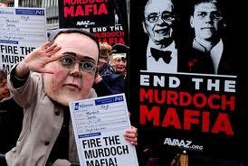 UK police arrest Murdoch tabloid staff, raid offices