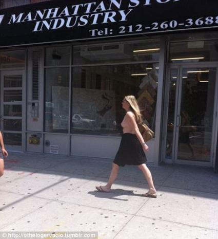 Mystery Topless Woman Walking Through Streets Of New York...