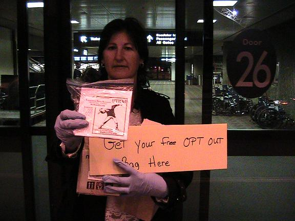 Donna Hancock outside of Phoenix Sky Harbor Airport at 6:00 a.m. handing out TSA 'Opt-Out' b