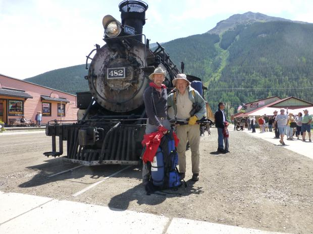 Frosty and Al standing in front of a locomotive in Silverton, Colorado