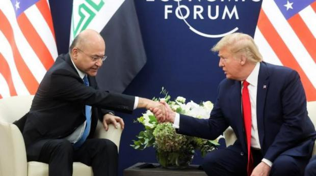 Iraqi President Denounced for Meeting with Trump in Davos